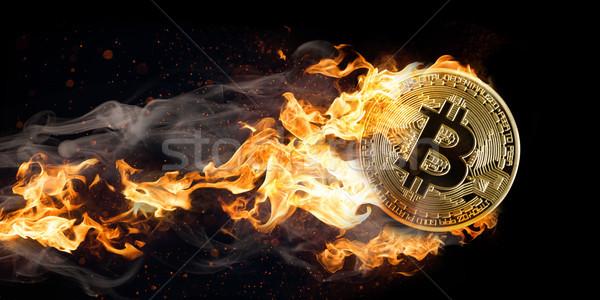 Fyling Burning Bitcoin Stock photo © limbi007