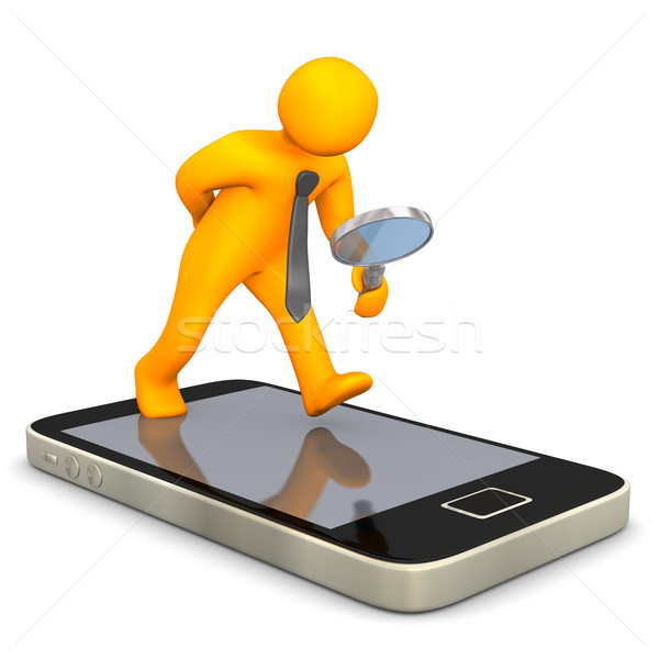 Businessman Loupe Smartphone Stock photo © limbi007