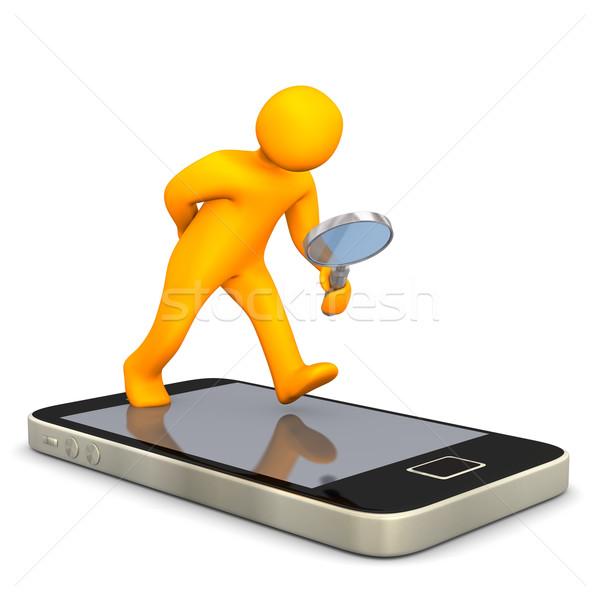 Smartphone Manikin Loupe Stock photo © limbi007
