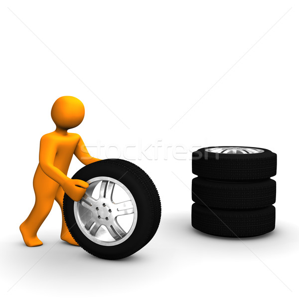 Hombre neumáticos figura coche negro Foto stock © limbi007