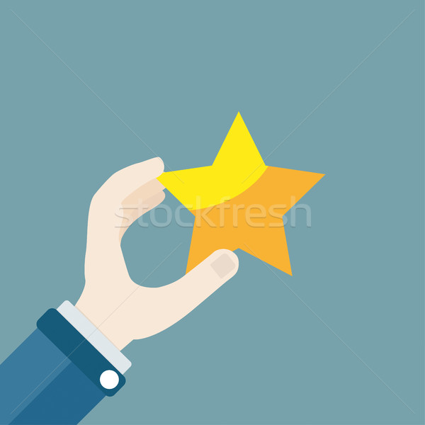 Hand Golden Star Stock photo © limbi007