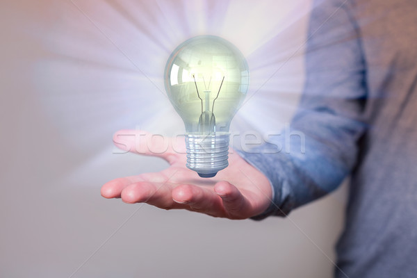 Menselijke hand lamp idee internet man school Stockfoto © limbi007