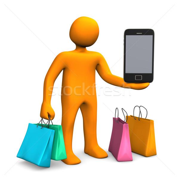 Mobile Shopping Manikin Stock photo © limbi007
