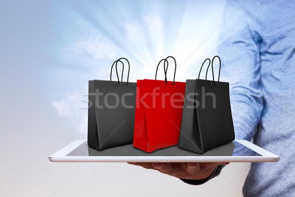 El tablet insan eli kırmızı siyah Stok fotoğraf © limbi007