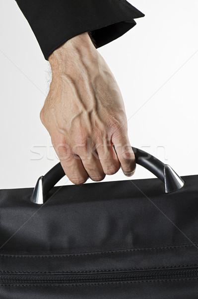 Işadamı el adam evrak çantası dikey Stok fotoğraf © limpido