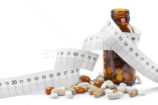 Hapları kapsül diyet şişe bant arka plan Stok fotoğraf © limpido
