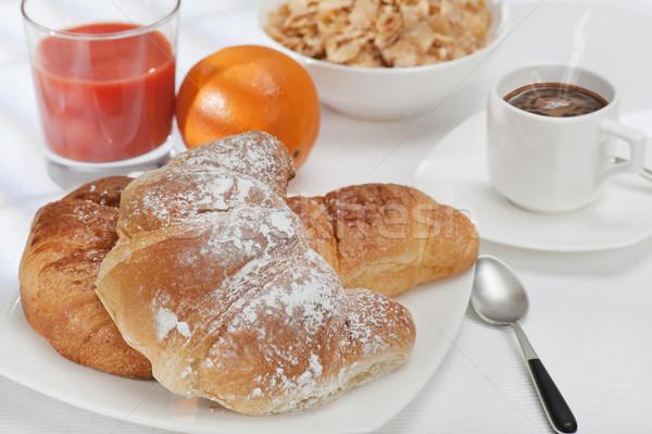 Colazione continentale fresche cornetto caffè succo d'arancia Foto d'archivio © limpido