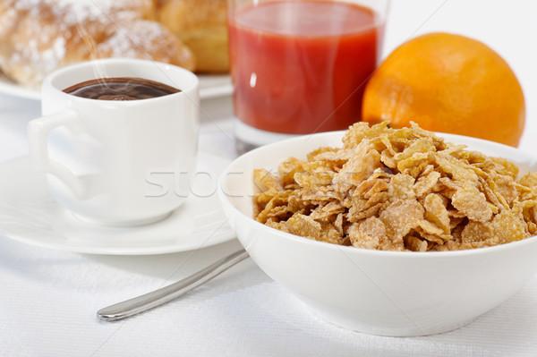 Continentaal ontbijt cornflakes koffie sinaasappelsap croissants voedsel Stockfoto © limpido