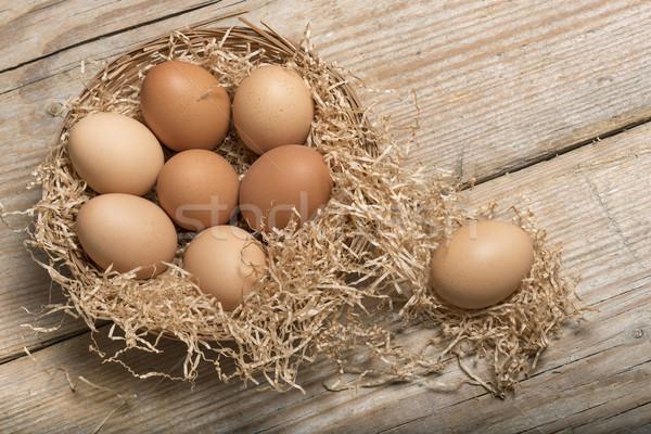Yumurta grup saman sepet ahşap masa gıda Stok fotoğraf © limpido