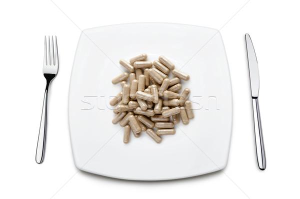 Hapları diyet plaka beyaz tıbbi çatal Stok fotoğraf © limpido