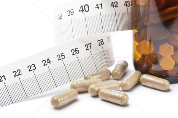 Tabletták kapszulák diéta üveg szalag háttér Stock fotó © limpido