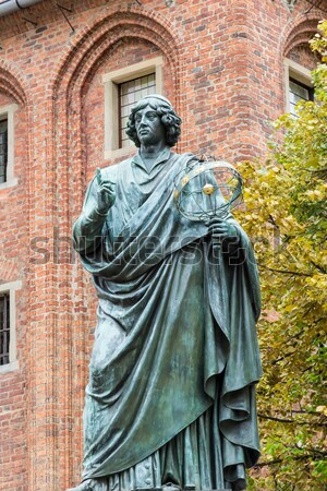 Monument of Copernicus against Town Hall in Torun. Home town of Copernicus. Stock photo © linfernum