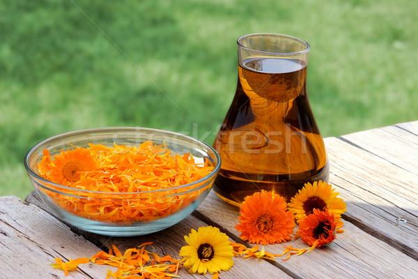 Calendula flowers and oil Stock photo © Lio22