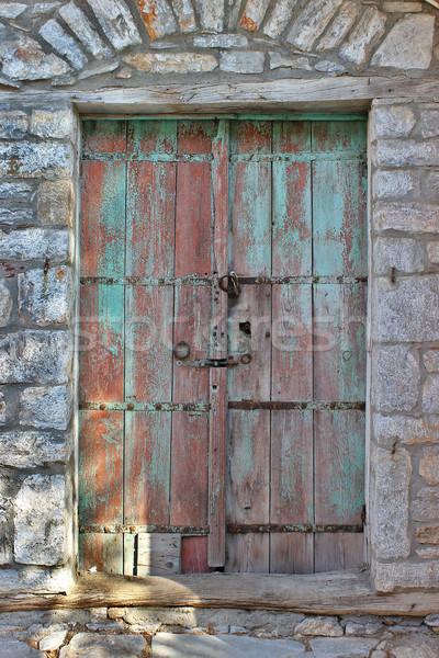 Wyblakły przednie drzwi starych kamień domu południe Zdjęcia stock © Lio22