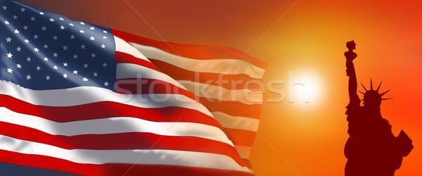 Amerikai zászló szobor hörcsög naplemente nap égbolt Stock fotó © liolle