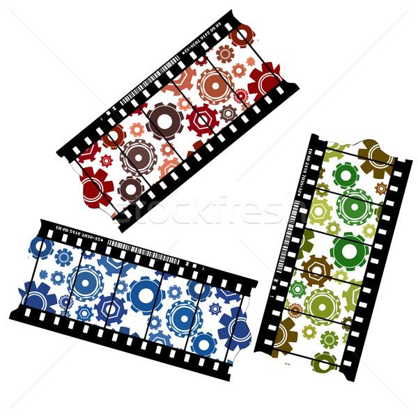 Cogwheels on a filmstrip Stock photo © lirch