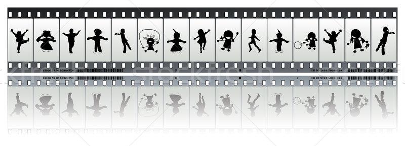 Negatív filmszalag gyerekek film sziluettek boldog Stock fotó © lirch