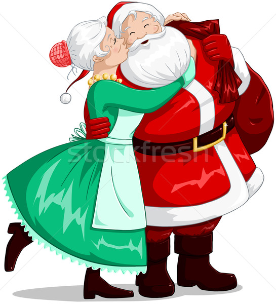 Mrs Claus Kisses Santa On Cheek And Hugs Stock photo © LironPeer