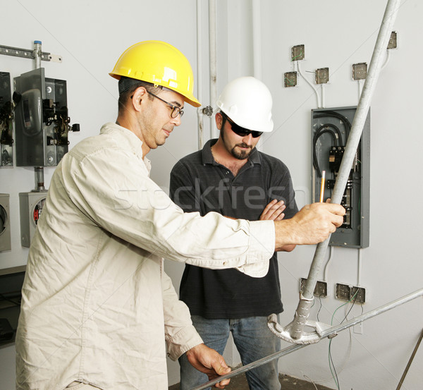 Electrical Team Bending Pipe Stock photo © lisafx