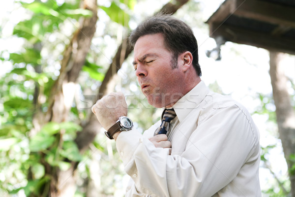 Businessman Coughing with Flu Stock photo © lisafx