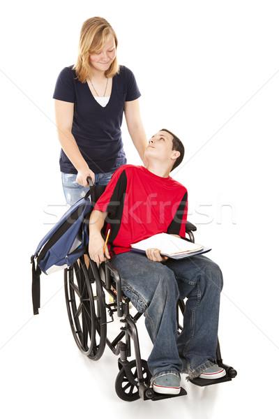 Gehandicapten jongen vriend tienermeisje voortvarend rolstoel Stockfoto © lisafx