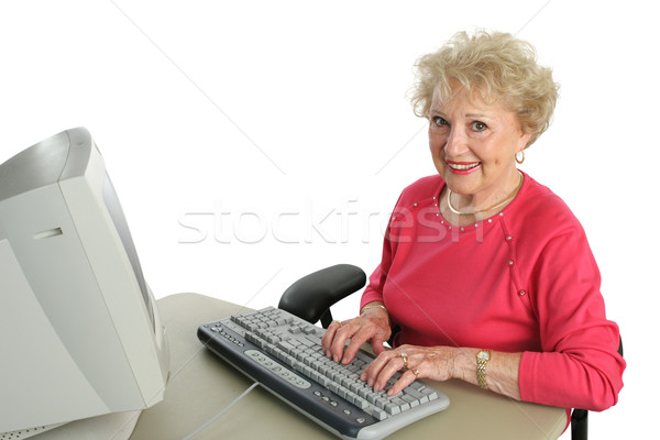 Senior Lady Enjoys Computer Stock photo © lisafx
