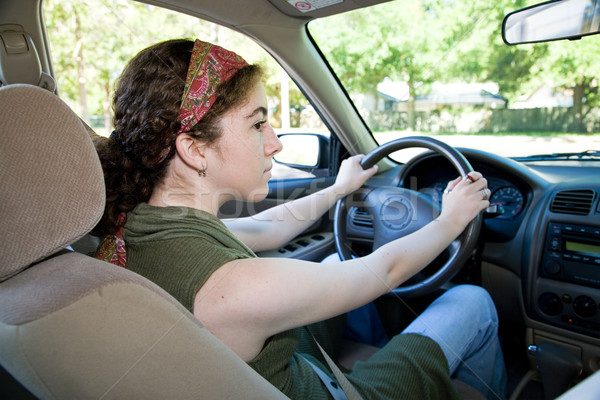 Teen Driver Looks Both Ways Stock photo © lisafx