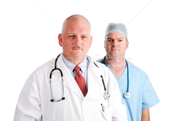 Mature Doctor and Surgical Intern Stock photo © lisafx