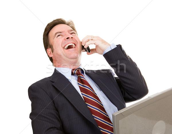 бизнесмен смеясь телефон ноутбука смешные Сток-фото © lisafx