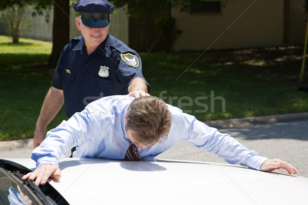 Işadamı tutuklama yüz aşağı polis araba Stok fotoğraf © lisafx