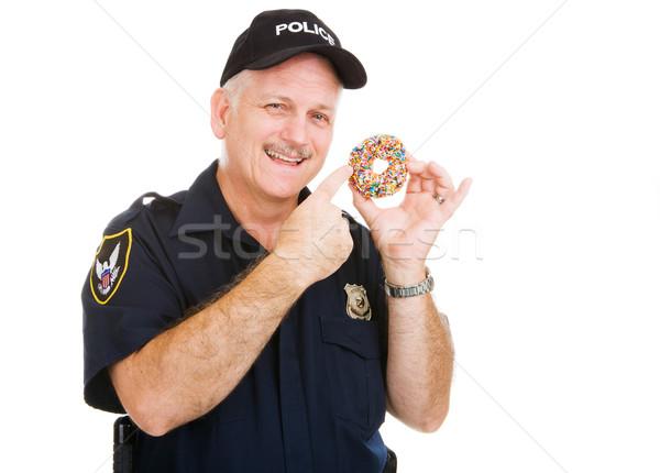 Policía senalando delicioso cubierto buñuelo Foto stock © lisafx