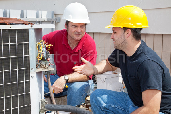 AC Technicians Discuss Problem Stock photo © lisafx