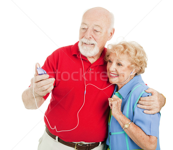 Senior Couple Listening to MP3s Stock photo © lisafx