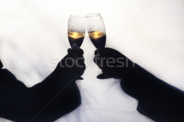 Stock photo: Silhoette of Champagne Toast
