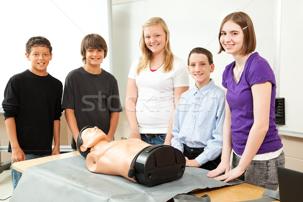 Teenagers with CPR Training Mannequin Stock photo © lisafx