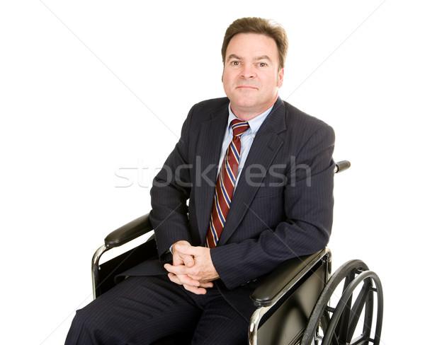 Inválido empresário dignidade cadeira de rodas sério isolado Foto stock © lisafx