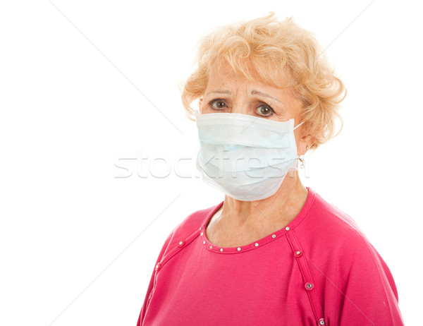 Salgın kıdemli kadın cerrahi maske Stok fotoğraf © lisafx