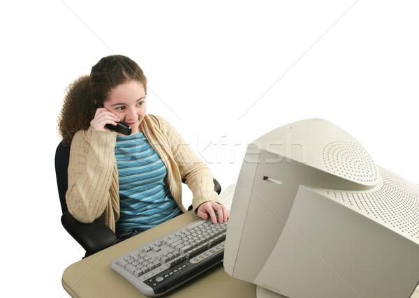 Compiti per casa consultazione teen girl computer telefono Foto d'archivio © lisafx