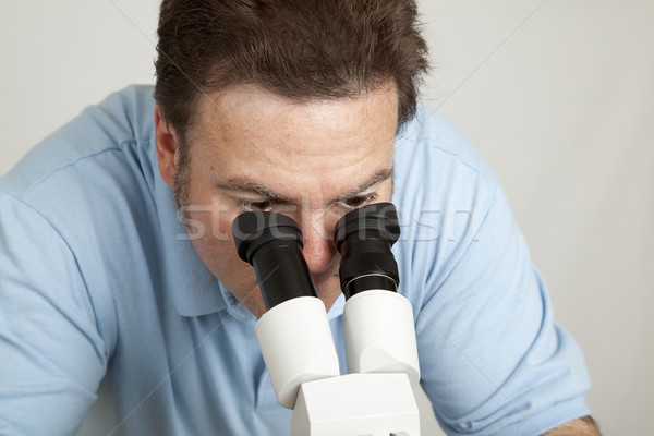 Looking Through Microscope Stock photo © lisafx