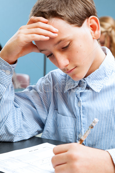 School Boy Concentrates on Standardized Test Stock photo © lisafx