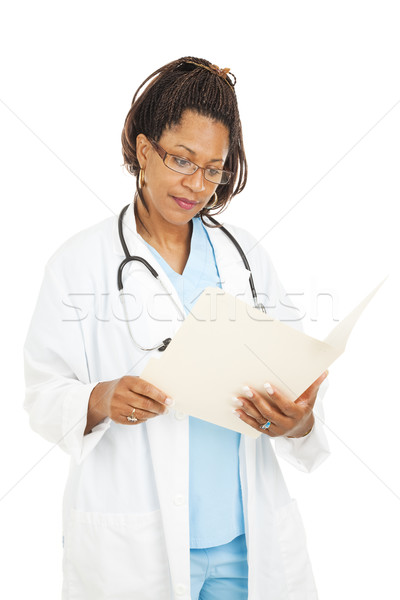 Pretty Doctor Reads Medical Chart Stock photo © lisafx