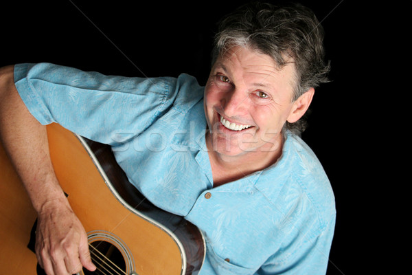 Grinning Guitarist Stock photo © lisafx
