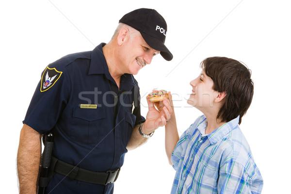 Politie gemeenschap betrekkingen puber jongen donut Stockfoto © lisafx