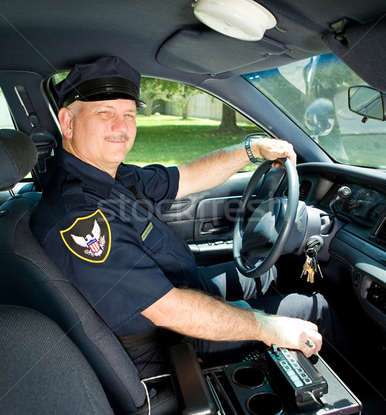 Police Officer Drives Squad Car Stock photo © lisafx