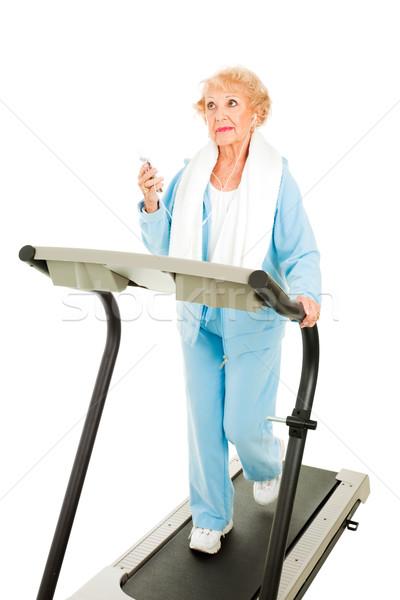 Laufband Senior Frau mP3-Player isoliert Stock foto © lisafx