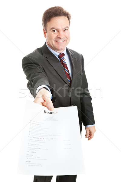 Stock photo: Confident Businessman Presents Resume