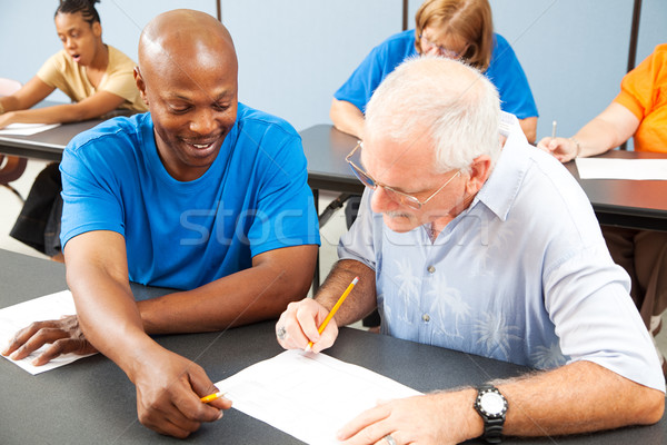Stock photo: College Student Tutors Older Classmate