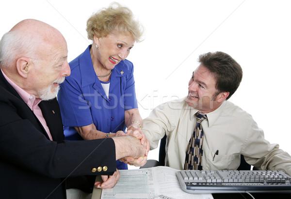 Impuesto grupo apretón de manos pareja de ancianos apretón de manos contador Foto stock © lisafx