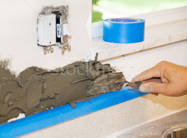 Tiler Applies Mortar Stock photo © lisafx