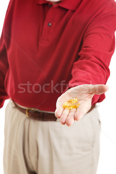 Stock photo: Omega 3 Fish Oil in Hand